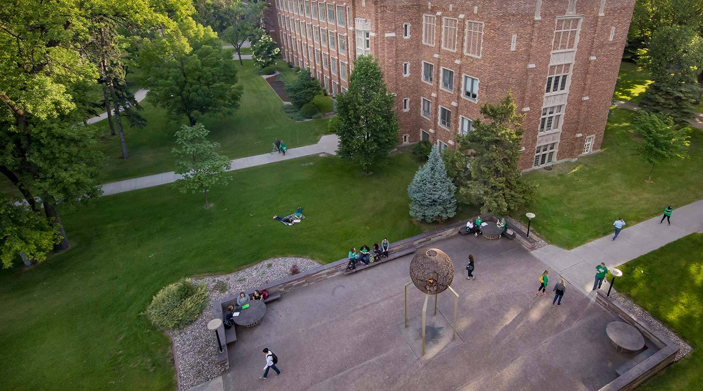 UND students walk near Eternal Flame