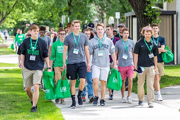 Students walking in quad during orientation
