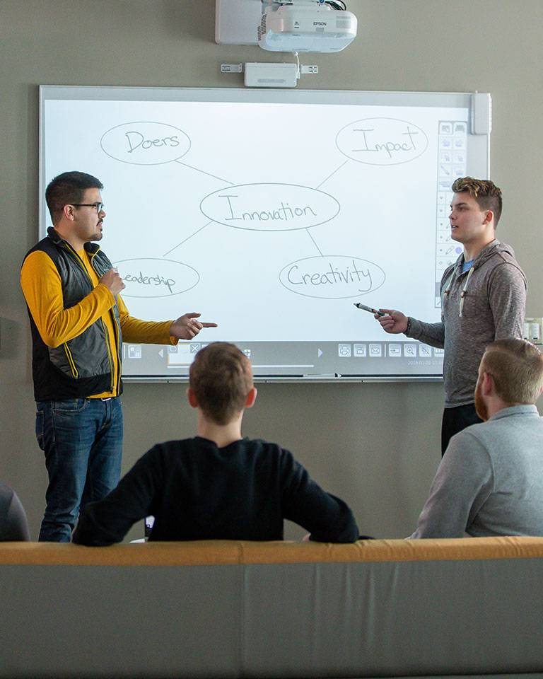 students in front of white board