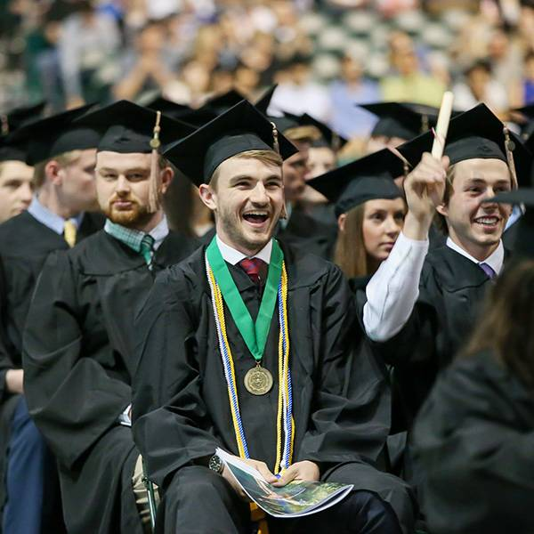 Student celebrating at commencement