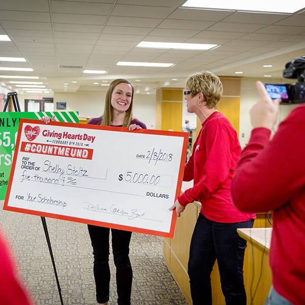 Student getting big scholarship check