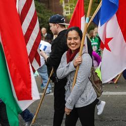 Smiling flag bearer during parade