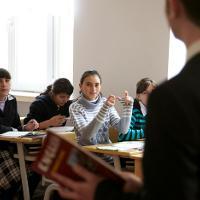 Girl learning English in classroom