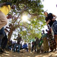 Group dancing in circle.