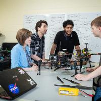 Students work together on a drone.