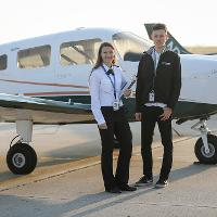 two people standing near plane