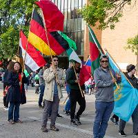 Students with flags in parade