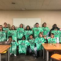 a photo of the emerging leaders llc students holding t-shirts