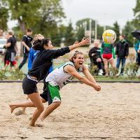 diving volleyball in the sand