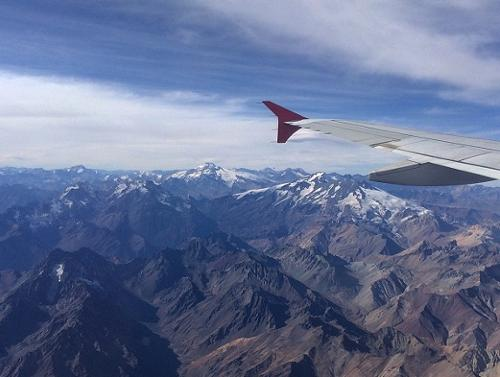 Airplane wing over the Andes mountains