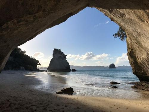 A view from the inside of a cave looking out to the ocean