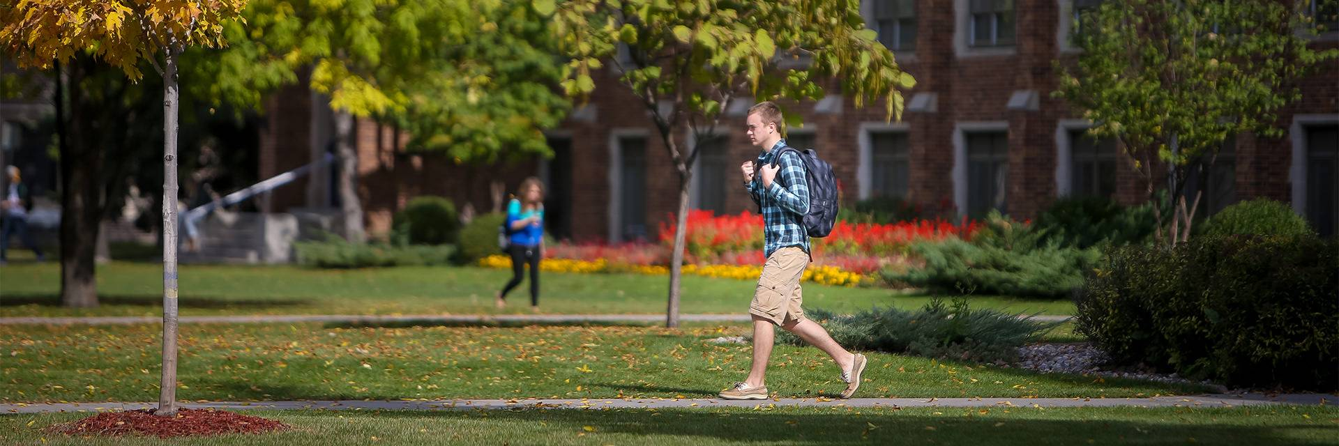 walking across campus during fall