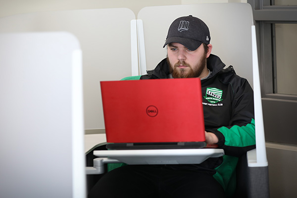 UND student working on laptop