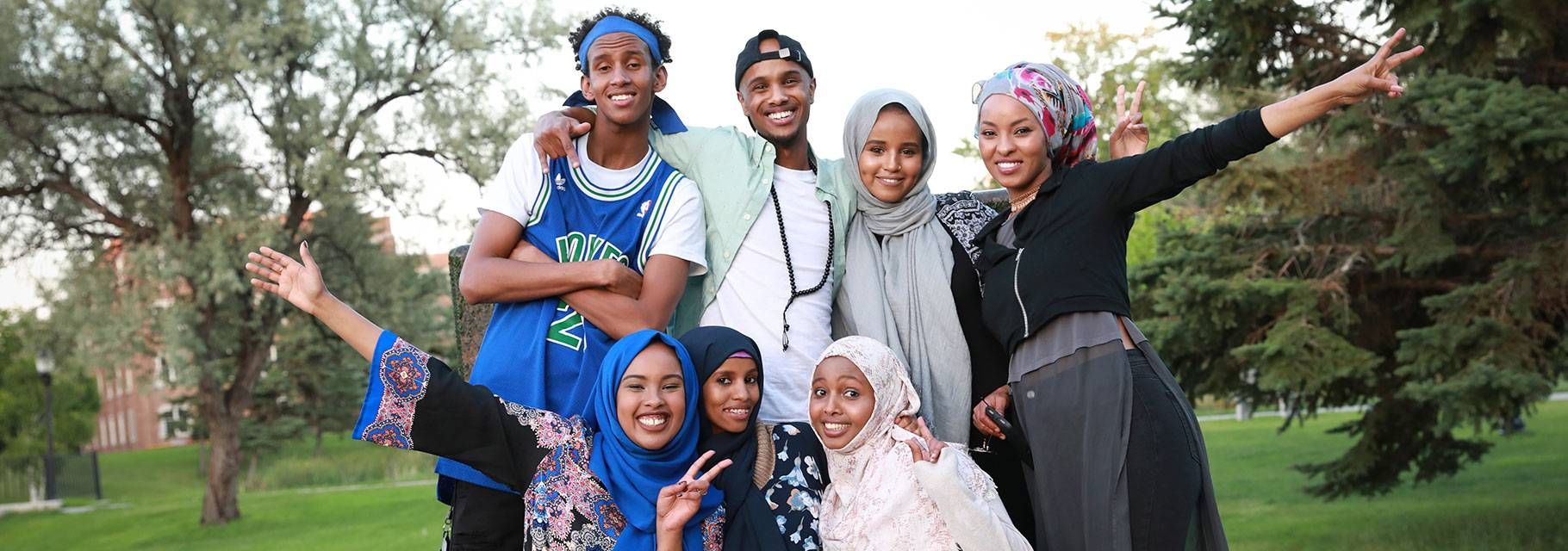 Students pose for a photo on campus