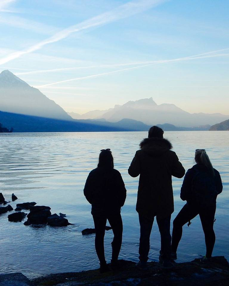 three students looking at mountains