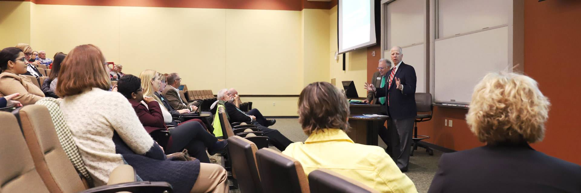 Provost speaking at an open forum