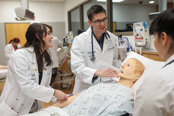 Medical students training on simulation mannequin