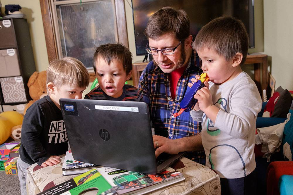 Dennis Bolda working with his three children