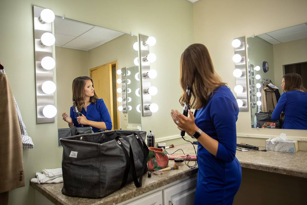 Lydia Blume readies for the morning news in the make-up room