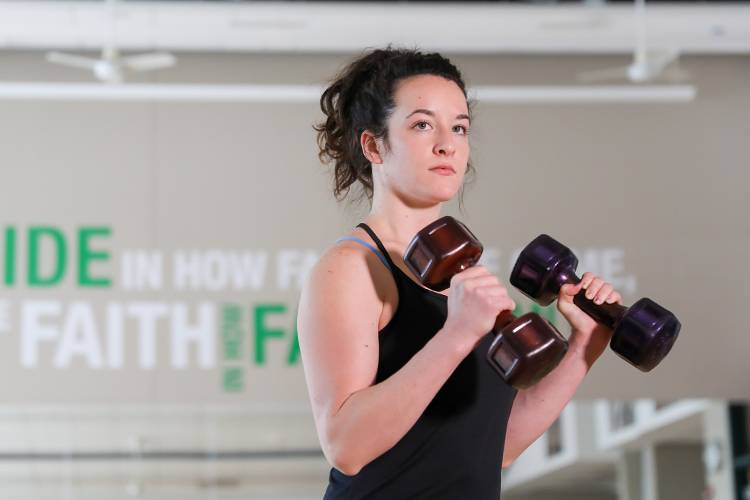 Stephanie Paro holding weights at Wellness Center