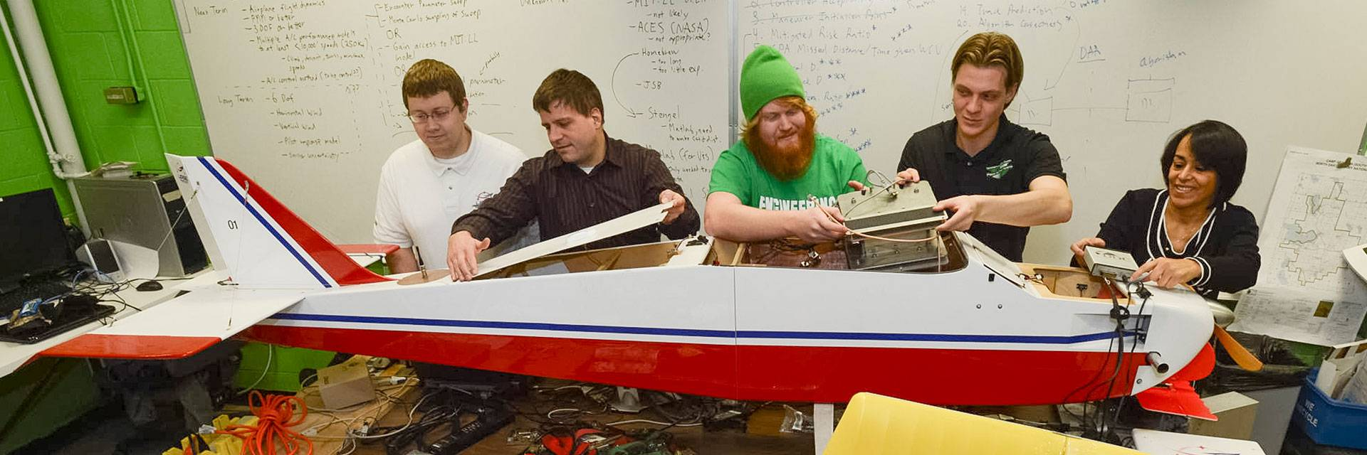 electrical engineering students working on model plane