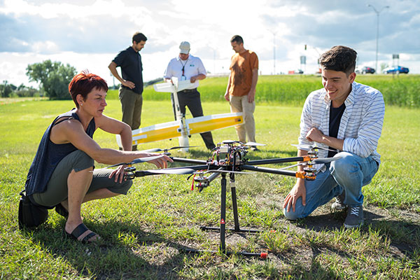 Faculty and student with UAV