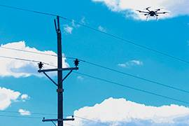 UAS flies over power lines