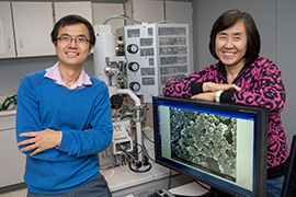 Julia Zhao posing for a picture in a lab.