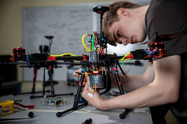 student working on drone