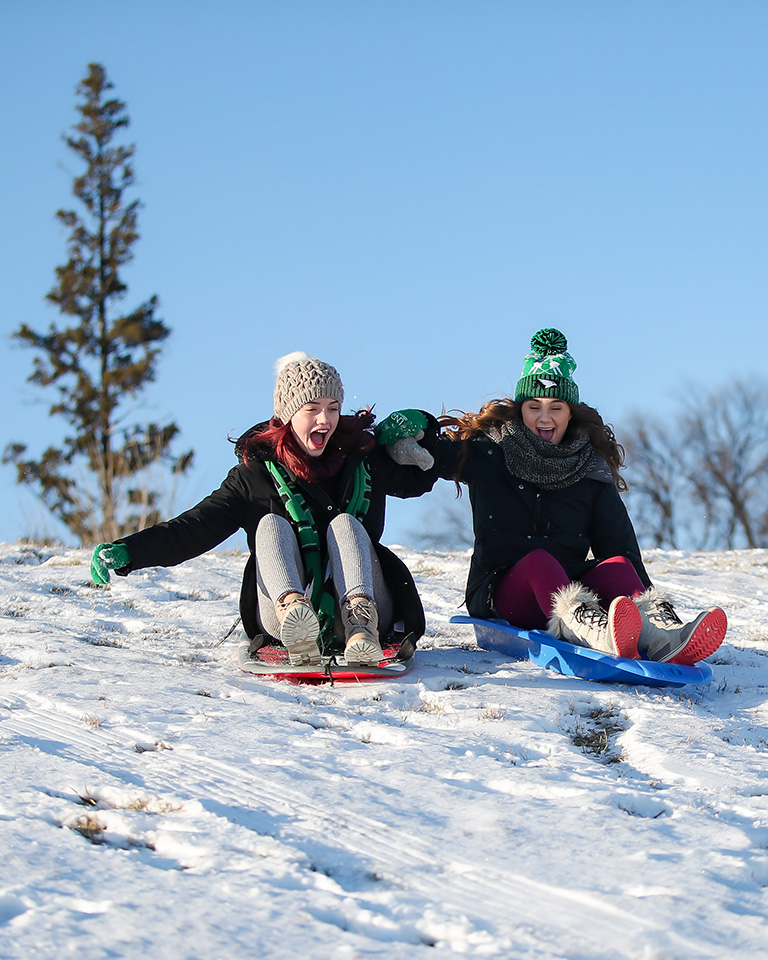 two students on sledding