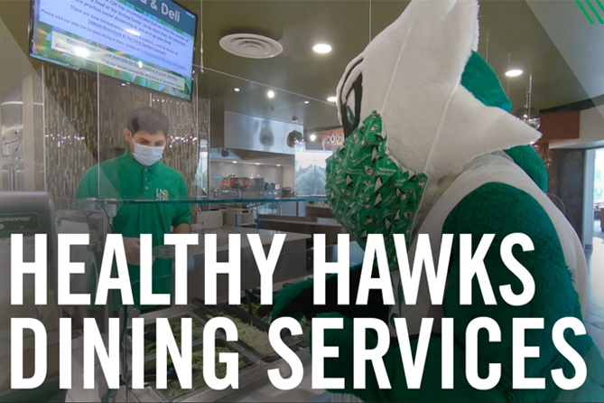 dining employee serving the fighting hawk mascot