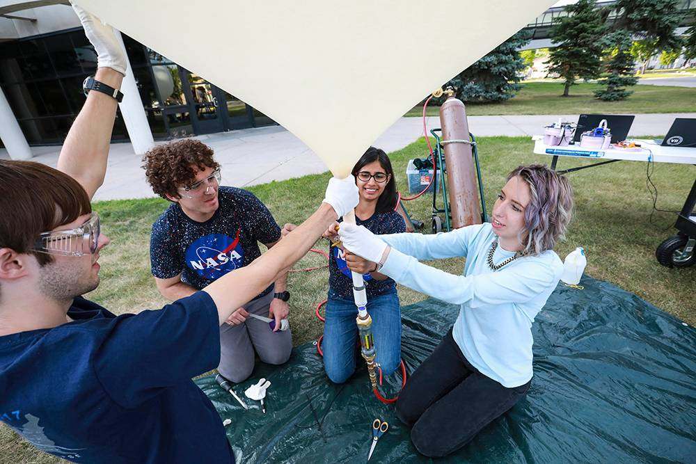 students work on weather balloon